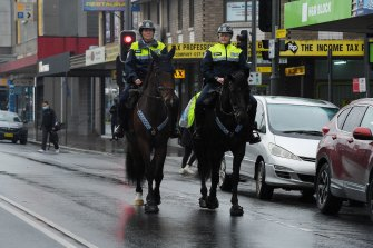 NSW mounted police patrol the streets of Fairfield yesterday.