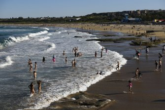 People flock to Sydney beaches as the temperature hits 28 degrees on Saturday.