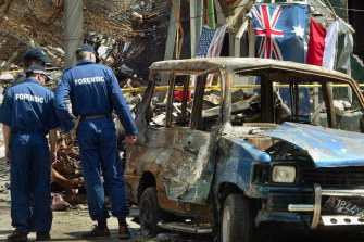 Members of Australian Forensic team investigate the site of the nightclub bombing in Kuta, Bali in 2002.