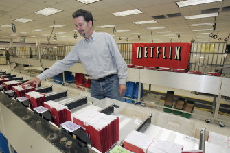 Hastings looks through DVD envelopes in 2005. Netflix now has 193 million subscribers in 190 countries, including 5.4 million accounts in Australia.