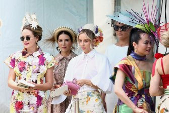 Entrants in the fashions on the field line up at the Magic Millions Race Day at Aquis Park on the Gold Coast.