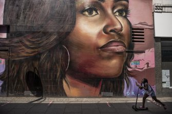 Michelle Obama, celebrated above in a mural in Brixton, discussed her depression this week