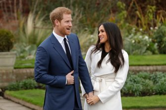 Harry and Meghan pose for photographers during a photo call in the grounds of Kensington Palace to mark the couple's engagement in 2017.