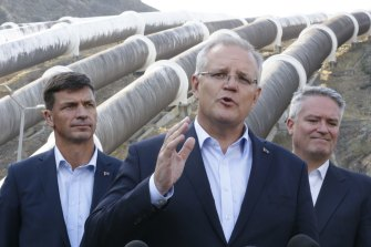 Minister for Energy Angus Taylor, the Prime Minister Scott Morrison and Minister for Finance and the Public Service Mathias Cormann at the Snowy Hydro Tumut 3 power station. Morrison has threatened to have the government-owned Snowy Hydro power company build a gas plant should private enterprise not step in and do it themselves.