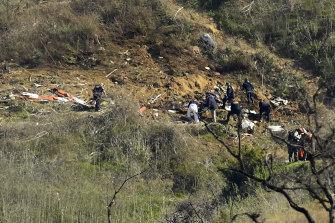 Investigators work the scene of the helicopter crash in California in 2020.