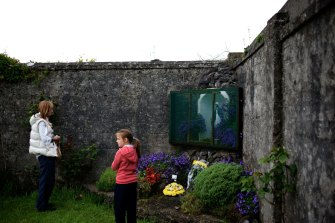 A mother and daughter visit the site where  796 children are believed to have been interred at St  Mary's Mother and Baby Home in Tuam, Ireland.