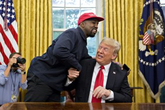 Rapper Kanye West shakes hands with US President Donald Trump during a meeting in the Oval Office of the White House in 2018.