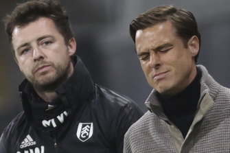 Fulham's manager Scott Parker, right, reacts during the loss to Burnley.