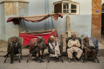 Labourers wait in the street to be hired, in Kabul, Afghanistan, on Sunday.