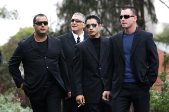 Mick Gatto (second from left) arrives at Saint Ignatius Church in Richmond for the funeral of Mario Condello in 2006.