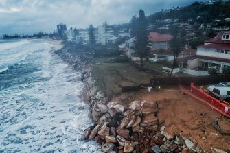 The latest beach erosion at Narrabeen exposed some of the makeshift material used to bolster the dunes during previous big storm events.