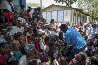 UNICEF Nutrition Specialist Joseph Senesie screens children for malnutrition in Adikeh, in the Wajirat district.