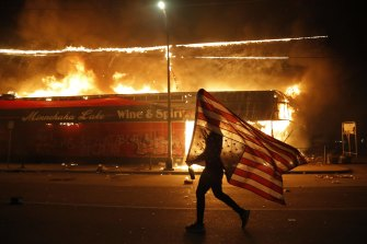 This May 28 photograph by Julio Cortez helped the Associated Press win the Pulitzer for breaking news photography.