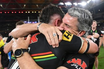 Nathan Cleary of the Panthers hugs his father and coach Ivan Cleary after winning the 2021 NRL grand final.