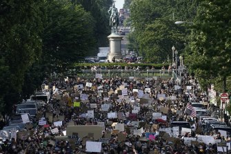 Demonstrators march toward Lafayette Park and the White House to protest against police brutality on Tuesday, June 2.