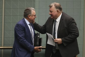 Craig Kelly talks to Labor's Joel Fitzgibbon (left), a fellow spruiker of coal. Kelly's decision to sit as an independent allows him to form opportunistic alliances.