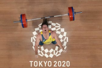 Matthew Ryan Lydement drops the barbel as he competes in the men's 109kg weightlifting event.