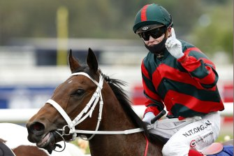 Craig Williams returns to scale on September Run after her Coolmore Stud Stakes win.