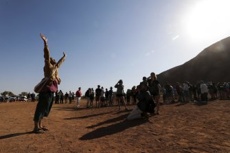 Japanese man Hikaru Ide pays his respect to Uluru and the wishes of the traditional owners and has chosen not to climb.