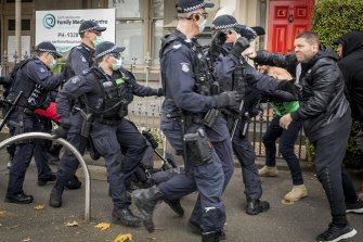 Victoria Police confront protesters in Victoria Street, North Melbourne, on May 29 for breaching lockdown directives.