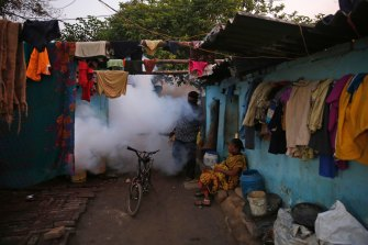 An Indian health worker fumigates to prevent the spread of mosquito-borne diseases in Allahabad, India.