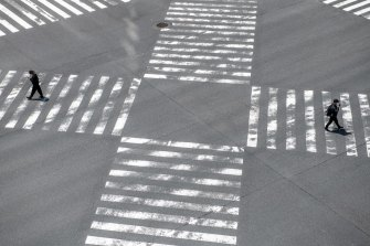 People walk over a pedestrian crossing in Ginza during the nationwide state of emergency.