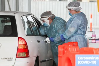 A nurse conducts a COVID-19 test at a drive-through facility in Geelong.