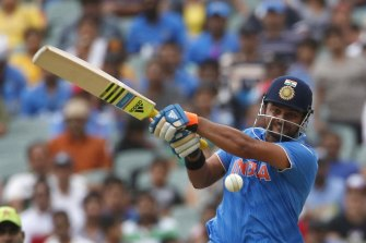 Suresh Raina, pictured at the 2015 World Cup, believe Indian players should be allowed to compete outside of the IPL.