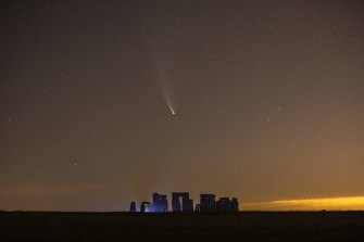 Comet NEOWISE passes over Stonehenge in the early hours of July 21  in Salisbury, England.