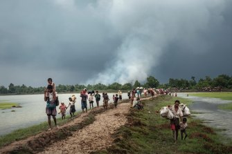 Rohingya refugees rest near the Naf River, which separates Myanmar and Bangladesh, after crossing the border in 2017.