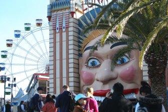 'A cavalier attitude': guests queue to enter Sydney's Luna Park last week.