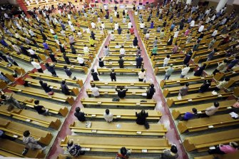 Christians wear face masks and maintain social distancing at a service at the Yoido Full Gospel Church in Seoul, South Korea on Sunday.