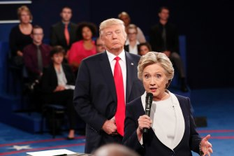 Donald Trump stands behind Hillary Clinton during a 2016 debate.