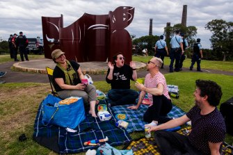 Picnickers in Sydney Park amid a heavy police presence.