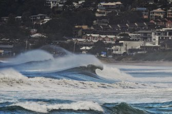 Heavy surf stirred up by an east coast low off the NSW coast in July 2020. The more damaging type of such events is on the increase in a warming world, IAG says.