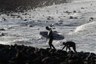 Formston navigating the boulders at Lennox Point surf break.