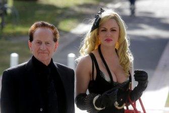 Geoffrey Edelsten and Gabi Grecko at Tom Hafey's funeral in 2014.