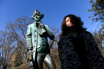 Genevieve Grieves next to the Captain James Cook statue at Cook's Cottage in Fitzroy Gardens.