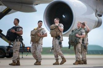 US Marines embark an aircraft at RAAF Base Darwin for their return home.