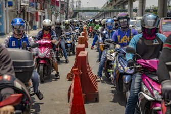 Motorists queue at a quarantine checkpoint in Manila, Philippines.
