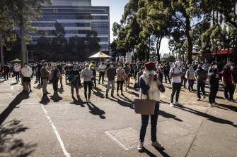 Huge crowds of people wait at the Sydney Olympic Park vaccination hub on August 16.