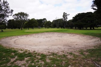 Rakes have been removed from bunkers at this bayside golf course.