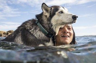 Mark Rushton cools off with husky Saskia.