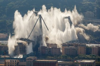 A cloud of dust rises as the remaining spans of the Morandi bridge are demolished in a planned explosion in June 2019.