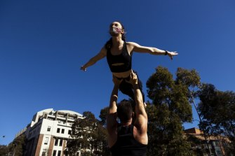 Acrobats Woody Fox and Amber Kaldor train at Harmony Park in Surry Hills.