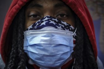 A subway rider wears a mask and a bandana for protection against COVID-19 in New York. The coronavirus has been previously been found to be hitting black Americans particularly hard. A new study points to the same situation in the UK.