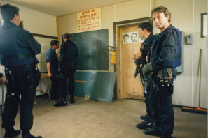Keith Banks (right, looking at camera) with other undercover police at a training facility.