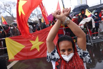 """Protesters chant """"Stop the genocide in Tigray!"""" during a demonstration against Ethiopia's war against Tigray regional forces near the Chinese Embassy in Berlin, Germany, earlier this month."""