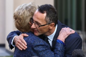 Former Greens leader Christine Milne embraces new Greens leader Richard Di Natale during a press conference in Parliament House in May 2015.