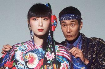 Kansai Yamamoto checks the dress of model Sayoko Yamaguchi in 1982.